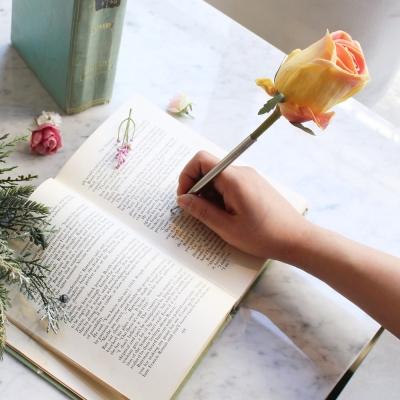 yellow orange tiny rose flower pen