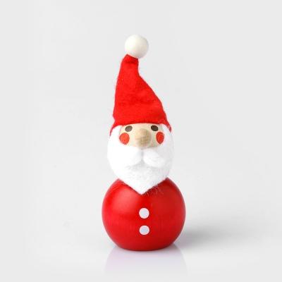Palm-sized doll Santa Claus