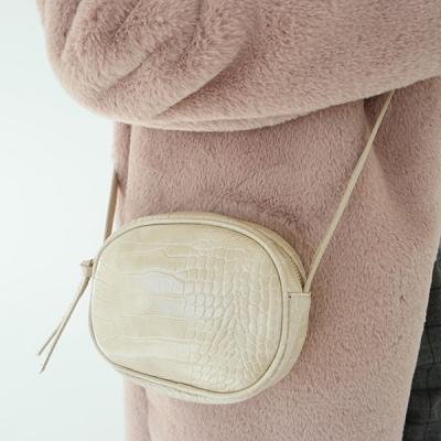 Crocodile round shoulder bag