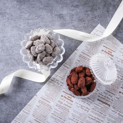수제 아망드 쇼콜라. 캐러맬라이징 된 아몬드 위에 달콤한 초콜릿!